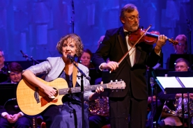 """Frances Drost and Dr. Mark Hartman entertain the crowd with her song """"MOPs""""."""