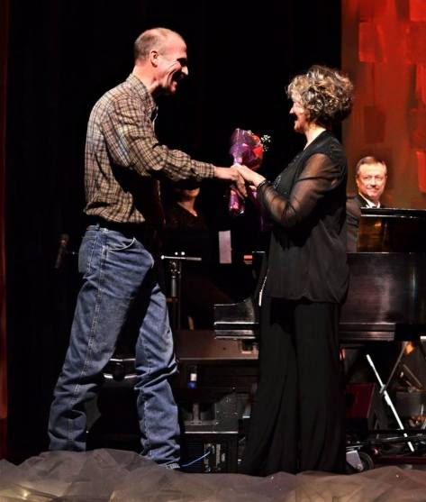 Tom Drost presents Frances with a bouquet. Behind every artist is a faithful spouse.